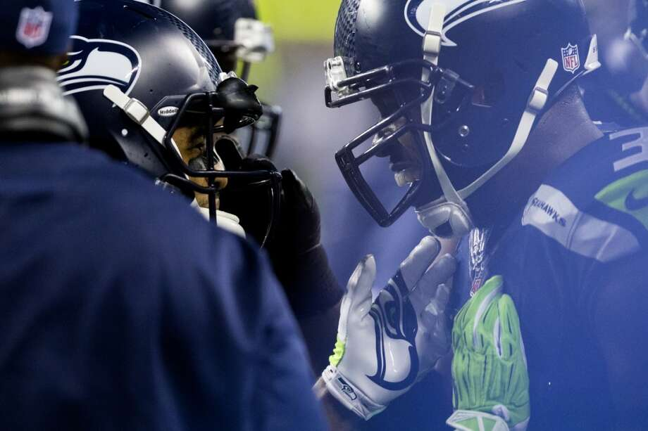 Kam Chancellor, right, is congratulated by teammates following a play in favor of the Seahawks during the second half. Photo: JORDAN STEAD, SEATTLEPI.COM