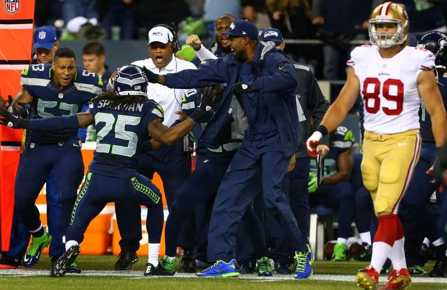 Seattle Seahawks player Richard Sherman reacts after tackling 49ers player Kyle Williams. Photo: JOSHUA TRUJILLO, SEATTLEPI.COM