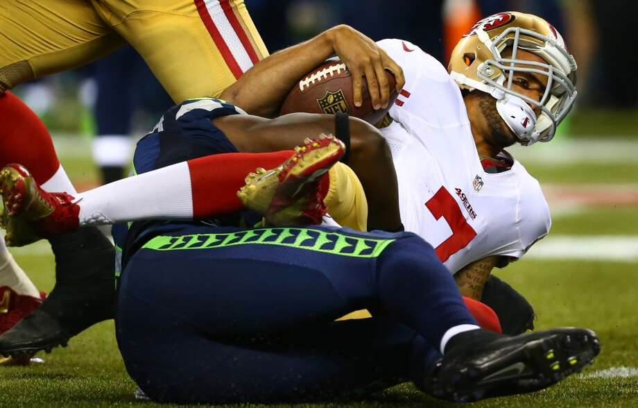 San Francisco 49ers quarterback Colin Kaepernick is sacked in the second half. Photo: JOSHUA TRUJILLO, SEATTLEPI.COM