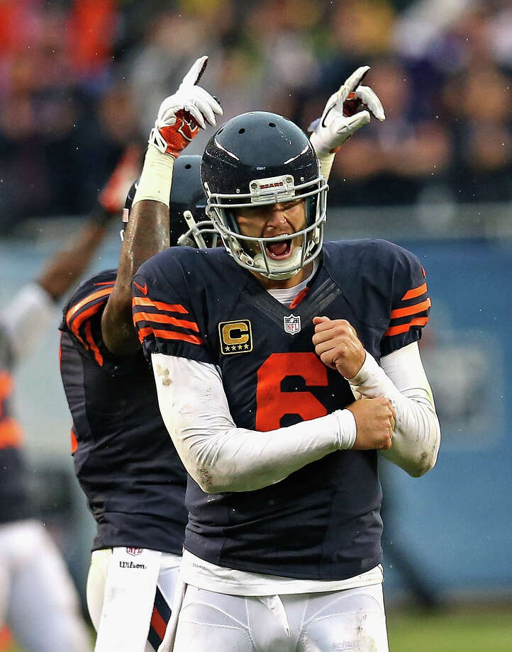CHICAGO, IL - SEPTEMBER 15:  Jay Cutler #6 and Alshon Jeffery #17 of the Chicago Bears celebrate the game-winning extra point against the Minnesota Vikings at Soldier Field on September 15, 2013 in Chicago, Illinois. The Bears defeated the Vikings 31-30.  (Photo by Jonathan Daniel/Getty Images) ORG XMIT: 175878256 Photo: Jonathan Daniel / 2013 Getty Images
