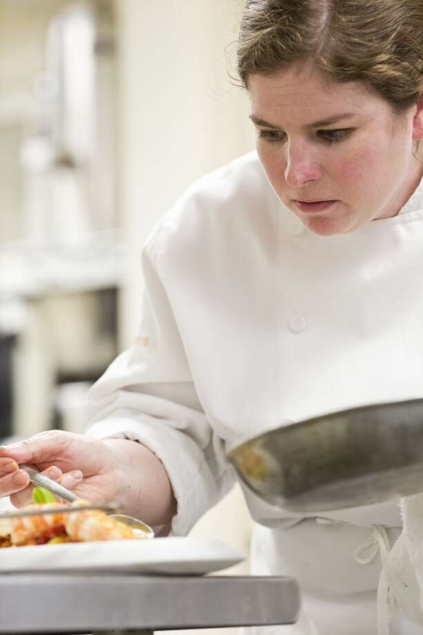 Marinus: Chef de cuisine Abby Burk plates a dish in the kitchen at Marinus in Carmel Valley Photo: Jason Henry, Special To The Chronicle