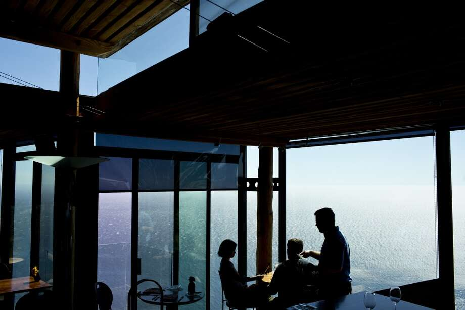 Sierra Mar: Diners inside Sierra Mar, which sits atop a cliff overlooking the Pacific in Big Sur. Photo: Jason Henry, Special To The Chronicle