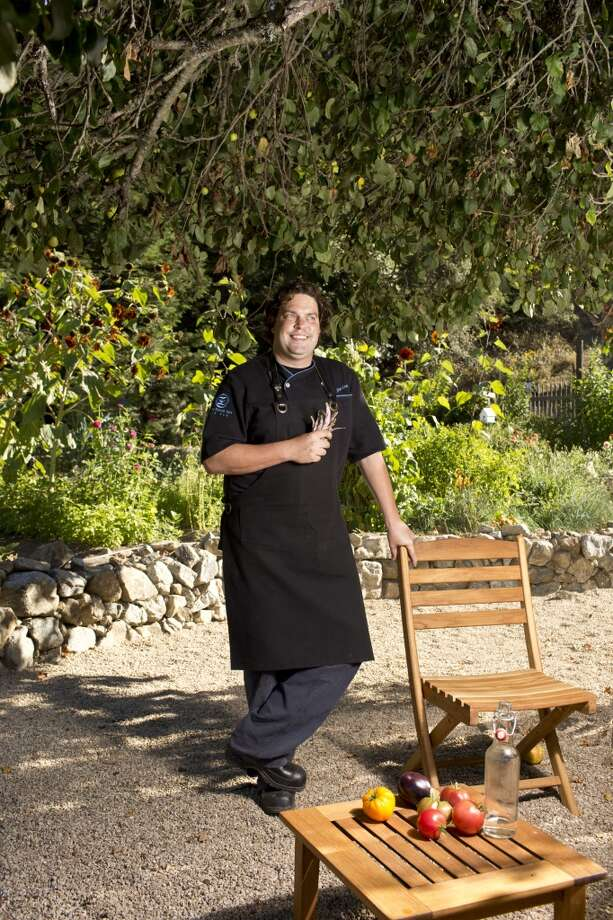 Sierra Mar: Chef John Cox with fresh picked beans in the garden at Sierra Mar in Big Sur. Photo: Jason Henry, Special To The Chronicle