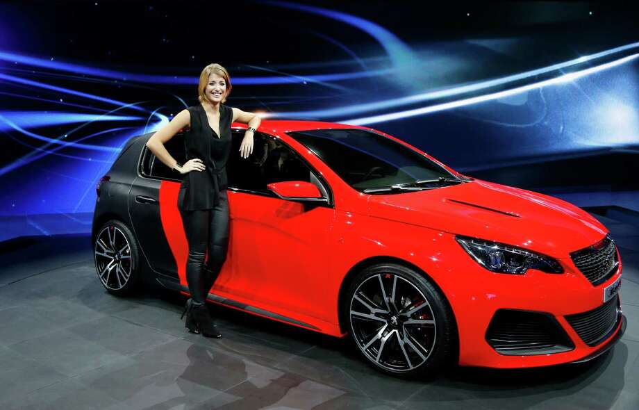 The new Peugeot 308 R is presented during the first press day of the 65th Frankfurt Auto Show in Frankfurt, Germany, Tuesday, Sept. 10, 2013. More than 1,000 exhibitors will show their products to the public from Sept. 12 through Sept.22, 2013. Photo: Frank Augstein