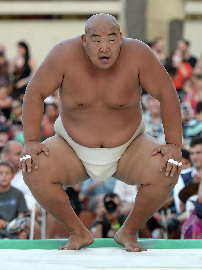Byambajav Ulambayar of Mongolia reacts to his win of the Men's Heavyweight Final over Soslan Gagloev of Russia during the13th US Sumo Open at the Japanese American Cultural & Community Center Plaza on September 15, 2013 in Los Angeles, California. Photo: Harry How, Getty Images / 2013 Getty Images
