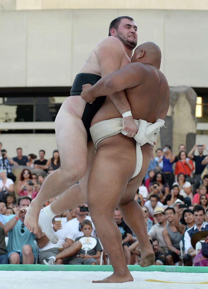 Byambajav Ulambayar of Mongolia lifts Soslan Gagloev of Russia off his feet and out of the ring to win the Men's Heavyweight Final during the13th US Sumo Open at the Japanese American Cultural & Community Center Plaza on September 15, 2013 in Los Angeles, California. Photo: Harry How, Getty Images / 2013 Getty Images