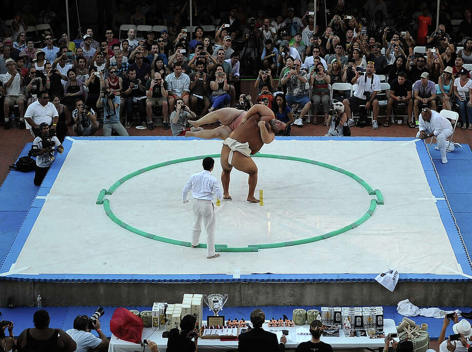 Kelly Gneiting is picked up by Byambajav Ulambayar of Monolia on way to victory in the Men's Heavyweight of the13th US Sumo Open at the Japanese American Cultural & Community Center Plaza on September 15, 2013 in Los Angeles, California. Photo: Harry How, Getty Images / 2013 Getty Images