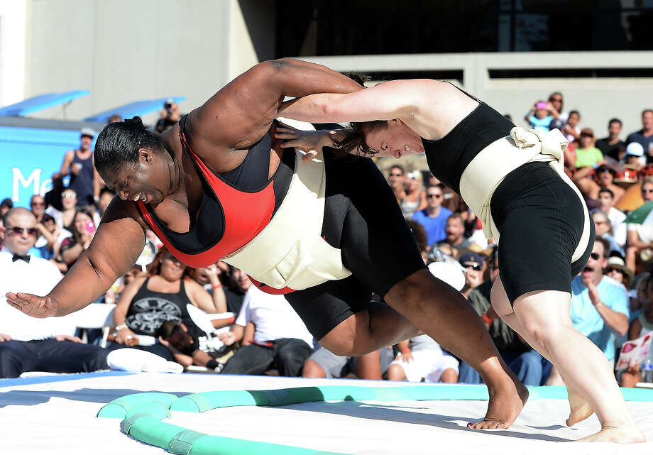 Sharran Alexander of Great Britain reacts as she is knocked out of the ring by Liz Seward to lose the Women's Openweight Final during the13th US Sumo Open at the Japanese American Cultural & Community Center Plaza on September 15, 2013 in Los Angeles, California. Photo: Harry How, Getty Images / 2013 Getty Images