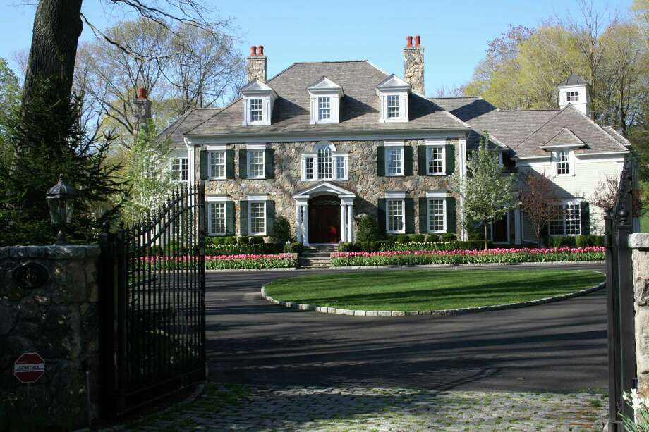 The Georgian-style home at 388 Wahackme Road in New Canaan has 12 rooms and six bedrooms, and is on the market for $5,200,000. Photo: Contributed