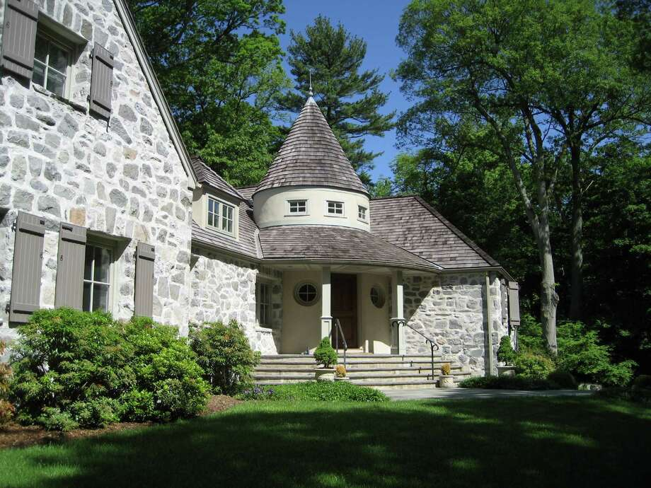 The Colonial stone house at 72 Delafield Island Road in Darien, built in 1937, was designed by Frazier Peters and includes nine rooms. It is on the market for $2,595,000. Photo: Contributed