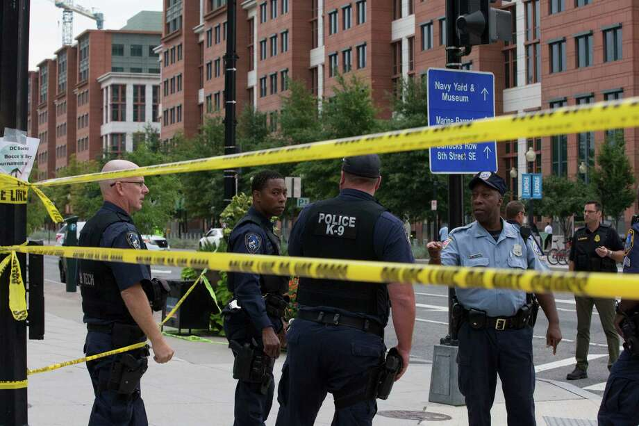 Police work the scene on M Street, SE in Washington near the Washington Navy Yard on Monday, Sept. 16, 2013. The U.S. Navy says one person is injured after a shooting at a Navy building in Washington. Police and emergency crews gathered Monday morning outside the Naval Sea Systems Command Headquarters building, where the shooting was reported. Photo: Jacquelyn Martin