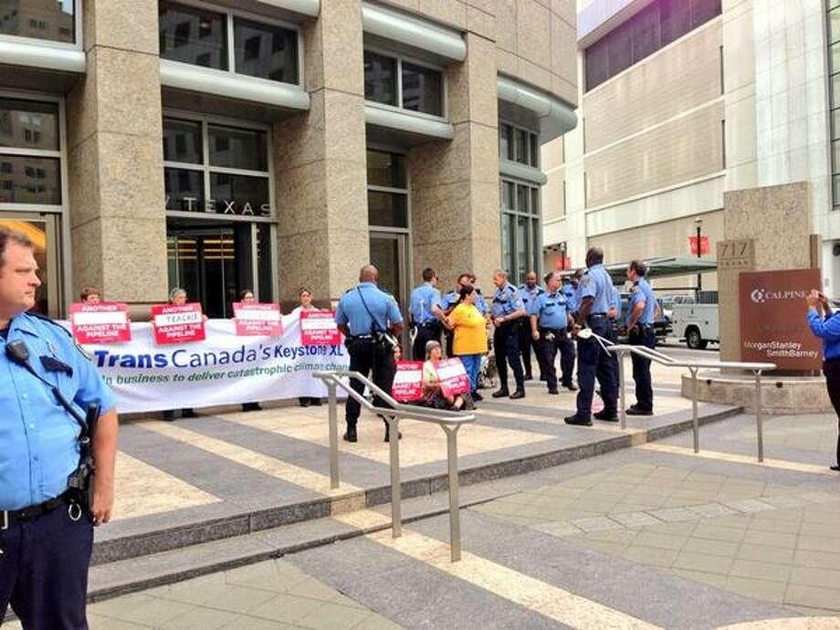 Protesters against the Keystone XL pipeline demonstrate in downtown Houston on Monday, September 16, 2013. (Zain Shauk/Houston Chronicle) Photo: Zain Shauk, Houston Chronicle