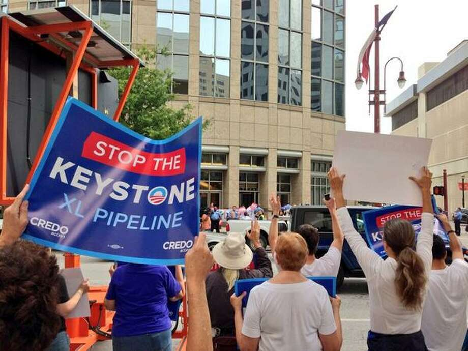 Protesters against the Keystone XL pipeline demonstrate in downtown Houston on Monday, September 16, 2013. (Zain Shauk/Houston Chronicle) Photo: Zain Shauk, Houston Chronicle
