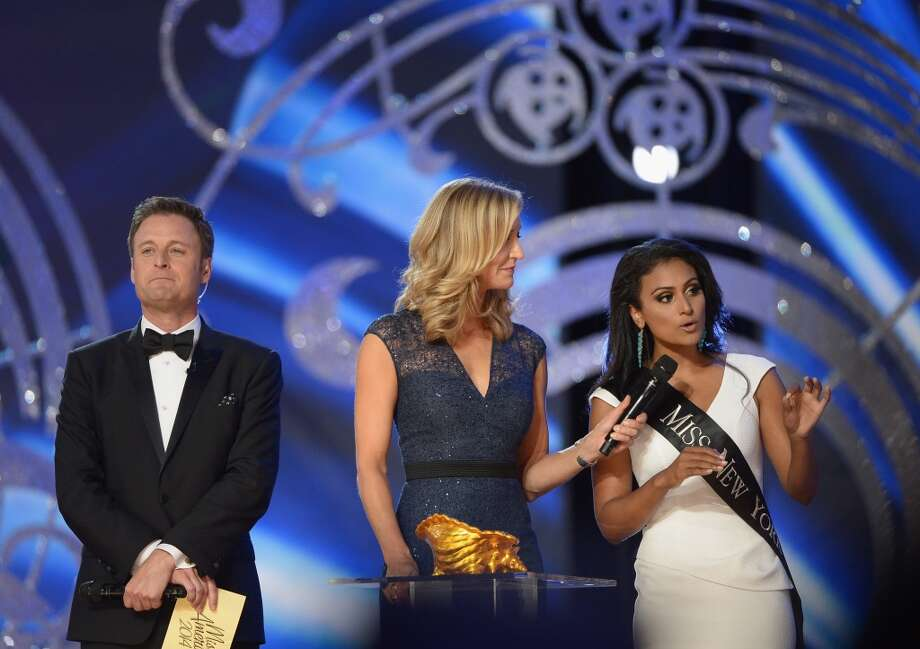 Miss America 2014 contestant Miss New York Nina Davuluri (R) performs in the questions portion with co-hosts TV personalities Chris Harrison (L) and Lara Spencer. Photo: Michael Loccisano, Getty Images