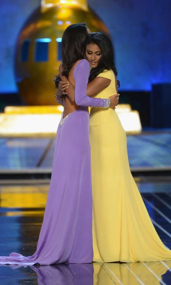 Miss America 2014 contestant Miss New York Nina Davuluri (R) and Miss California Crystal Lee embrace. Photo: Michael Loccisano, Getty Images