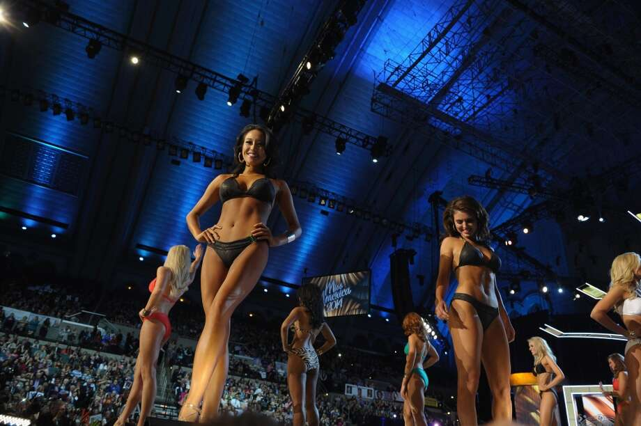 Miss America 2014 contestants perform in the bathing suit portion of the 2014 Miss America Competition. Photo: Michael Loccisano, Getty Images