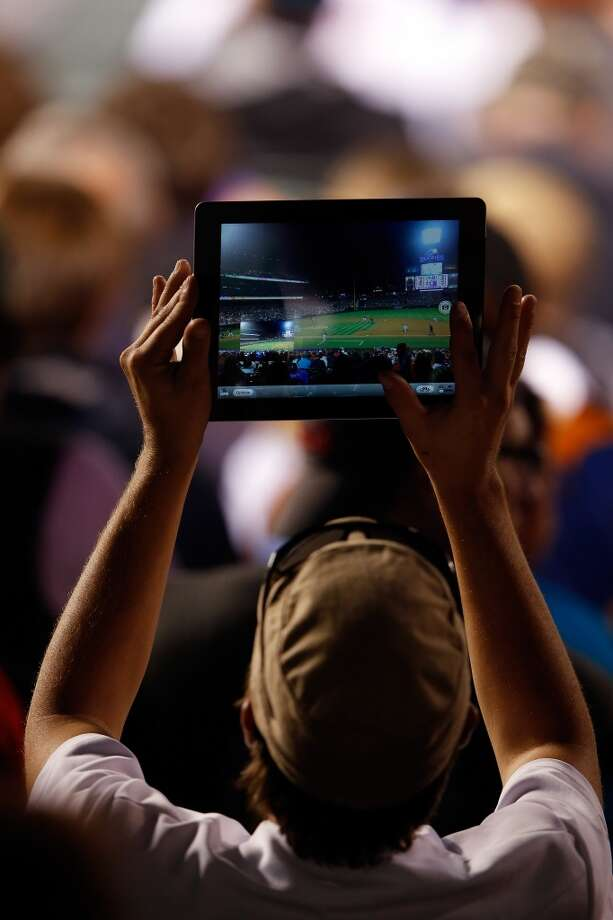 How can we convince America to stop using iPads to take photos of concerts and sporting events? Photo: Doug Pensinger, Getty Images