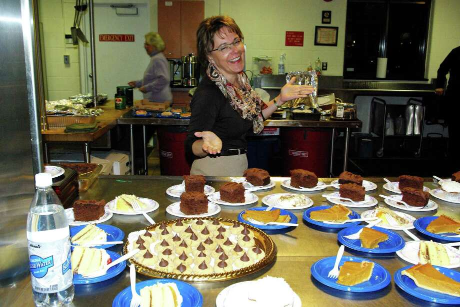 Susan Liguori prepares to serve the desserts at one of the Alpha Experience nights at St. John Church in Darien. Photo: Contributed