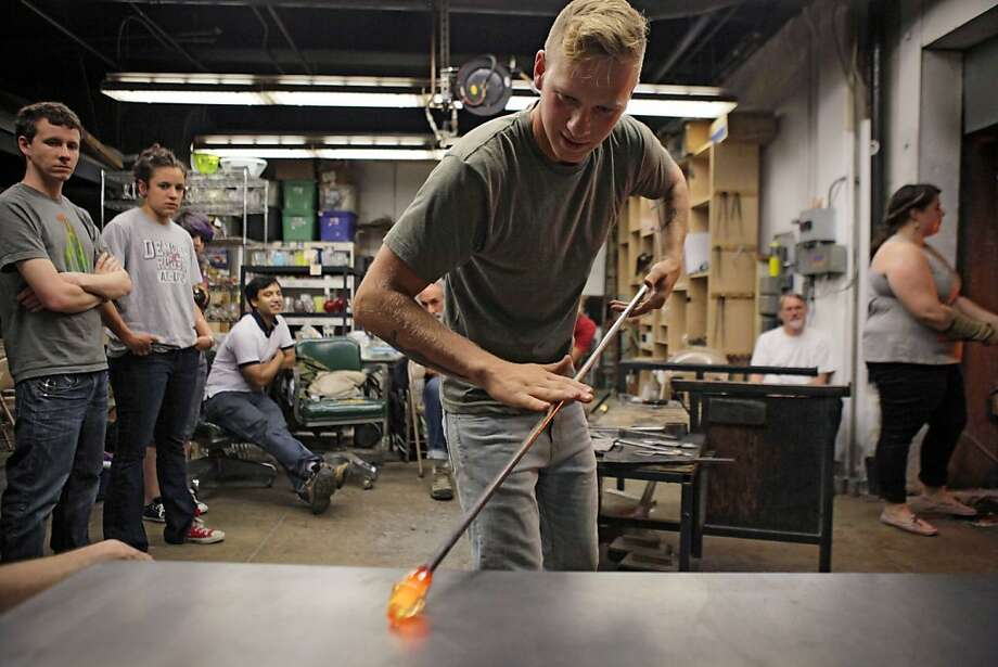 S.F. State senior Matt Wesley pays extra to take the glassblowing class, which is losing its place at the campus. Photo: Carlos Avila Gonzalez, The Chronicle