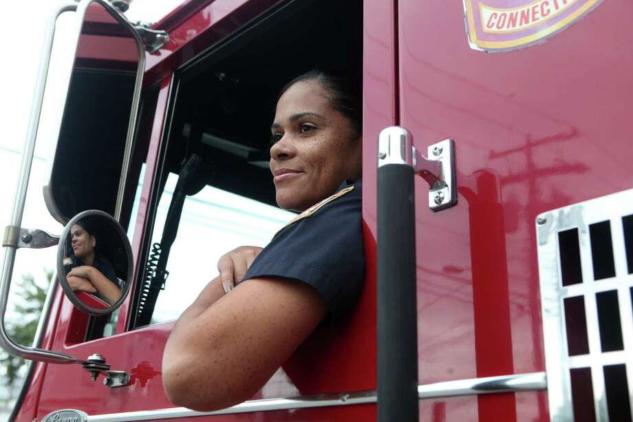 Bridgeport firefighter Sheilyan Vega is promoted to pumper engineer and sits in the driver seat  at Station 3 - firehouse in Bridgeport, Conn. on Monday, Sept. 16. 2013. Photo: BK Angeletti, B.K. Angeletti / Connecticut Post freelance B.K. Angeletti