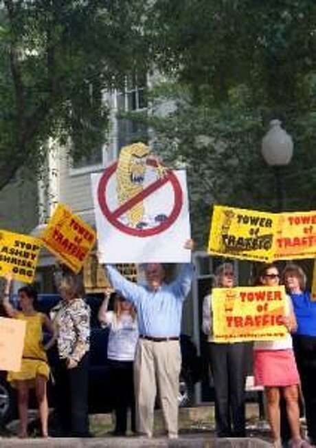 """From 2013: Protestors rally against the """"Ashby high-rise."""" Communities with the time, resources and political clout essentially have the power to restrict development within their borders, says professor Matthew Festa.  That pushes it to other areas without a meaningful discussion of the  citywide implications."""