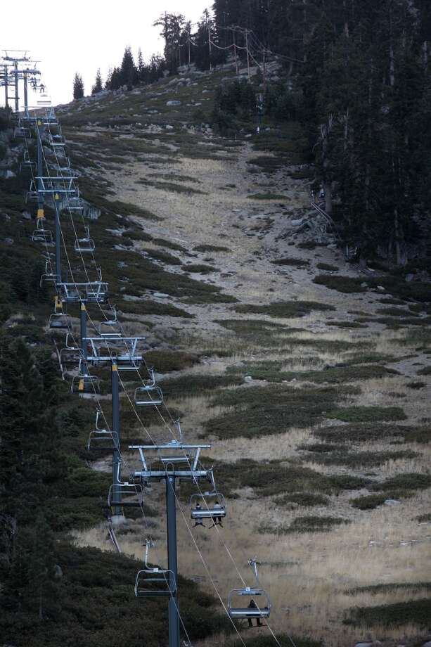 Gunbarrel at Heavenly Valley ski resort is snowless as snowboarders and skiers take the lift to the manmade snow at the top of the lift in South Lake Tahoe, Calif., on Wednesday, January 4, 2012.  Heavenly is running 26 ski runs out of the normal 97 and has more snow than anyone else in the area. Photo: Liz Hafalia, The Chronicle