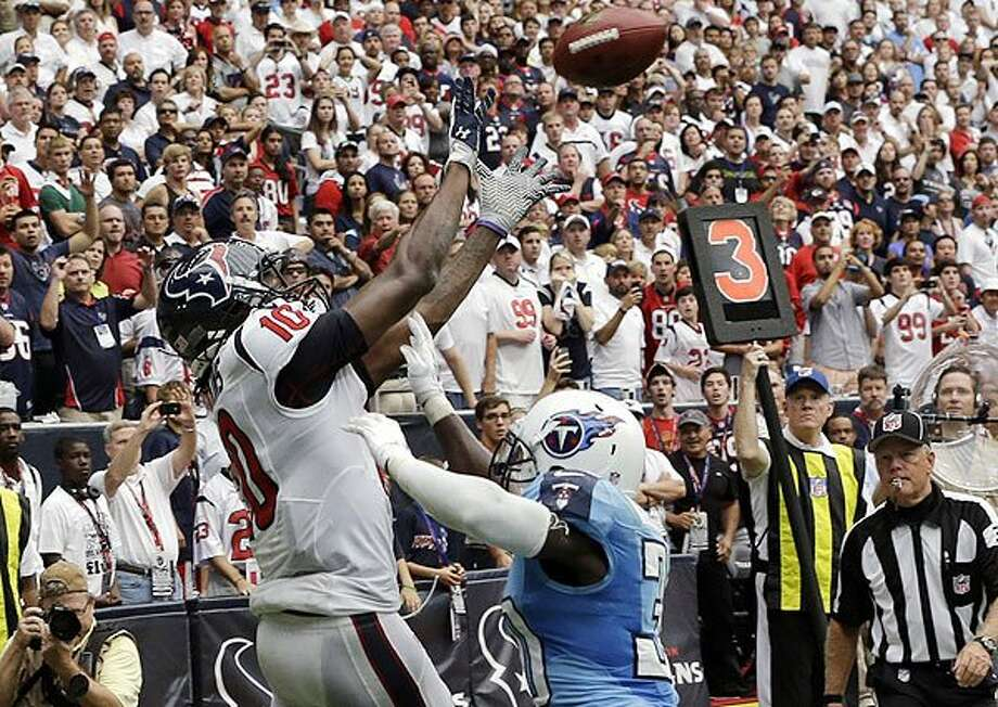 Texans 30 Titans 24.  Rave rookie Hopkins delivers in crunch time for the game-winning grab.