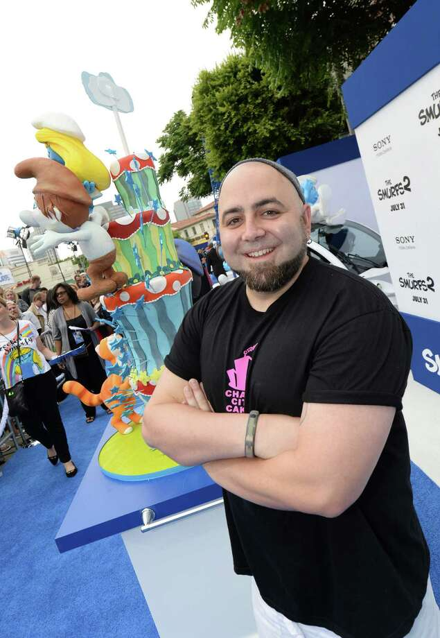 "Chef Duff Goldman attends the Los Angeles premiere of ""The Smurfs 2"" at Regency Village Theatre on July 28, 2013, in Westwood, Calif., with a cake made by his Charm City Cakes. Goldman will be at the Greenwich (Conn.)Wine and Food Festival at Roger Sherman Baldwin Park, which will run Oct. 3 to 5, 2013. Goldman plans on doing a baking demonstration at 2:30 p.m. on Oct. 5 at one of the demonstration tents. For information on the schedule and admission, visit www.greenwichwineandfood.com. (Photo by Michael Buckner/Getty Images for SONY) Photo: Contributed Photo / Stamford Advocate Contributed"