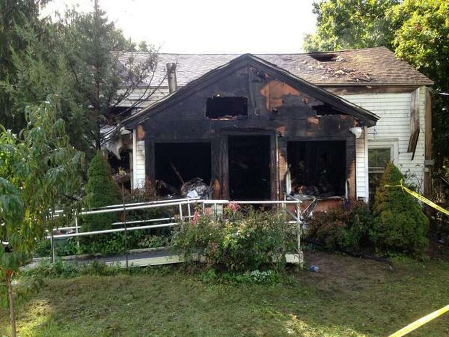 Devin Hover, 29, died when fire fire tore through this house in Poestenkill late Sunday. The fire  sent both his parents to the hospital as well, the Rensselaer County Sheriff's Office said. (Skip Dickstein / Times Union)