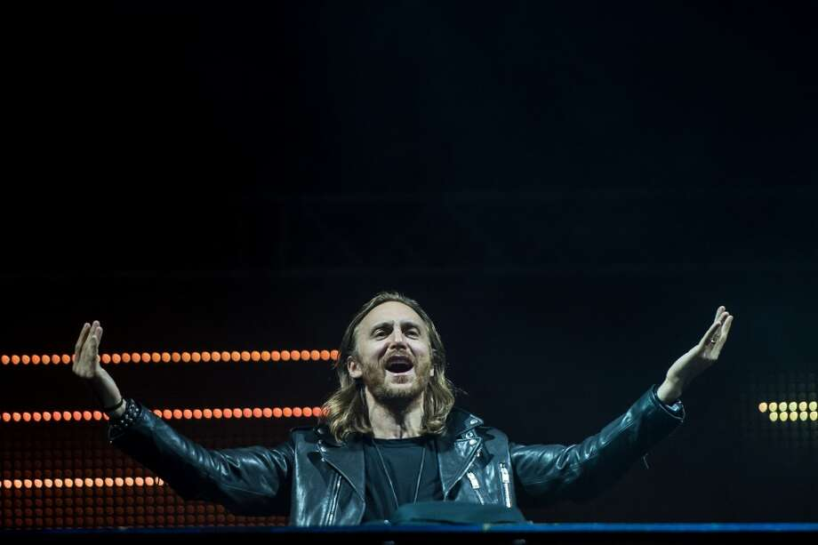 DJ David Guetta performs on stage during a concert in the Rock in Rio Festival on September 13, 2013 in Rio de Janeiro, Brazil. (Photo by Buda Mendes/Getty Images) Photo: Buda Mendes, Getty Images