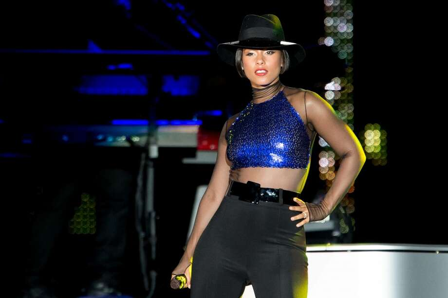Alicia Keys performs on stage during a concert in the Rock in Rio Festival on September 15, 2013 in Rio de Janeiro, Brazil. (Photo by Buda Mendes/Getty Images) Photo: Buda Mendes, Getty Images