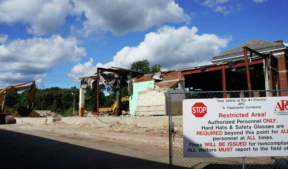 Work continues on the former U.S. Post Office on the Post Road, soon to be a Plan B Burger Bar along with some retail shops. Photo: Genevieve Reilly / Fairfield Citizen