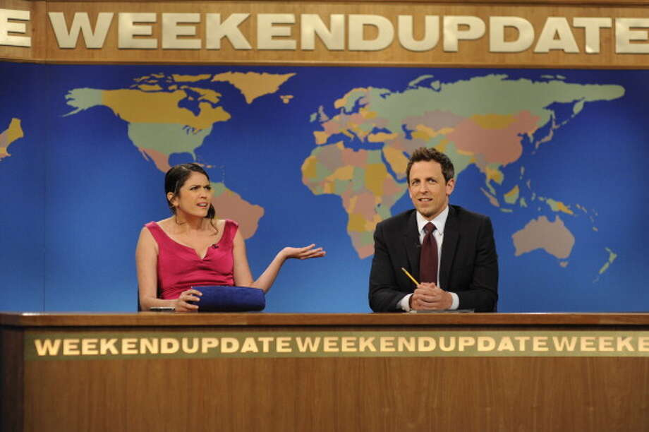 ROLE CHANGE: Second-year cast member Cecily Strong, left, will join Seth Meyers as the new 'Weekend Update' co-anchor, then take over full anchor duties when Meyers departs to host 'Late Night' beginning in February. (Photo by: Dana Edelson/NBC/NBCU Photo Bank via Getty Images) Photo: NBC, NBCU Photo Bank Via Getty Images / 2013 NBCUniversal Media, LLC..