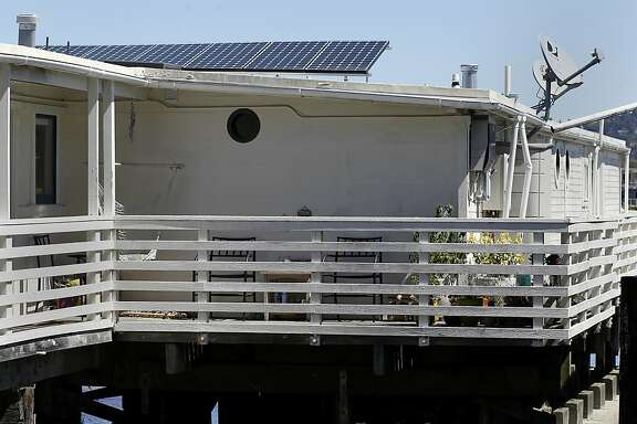 A home on the main dock even has solar panels and satellite dish Tuesday August 27, 2013. The upcoming Floating Home Tour in Sausalito, Calif. highlights life on a houseboat on the piers.