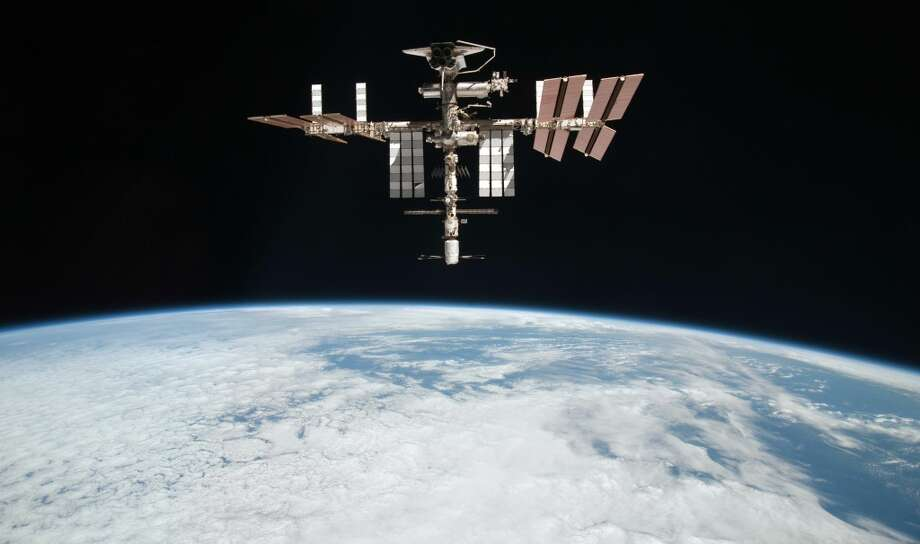 This May 23, 2011 file photo released by NASA shows the International Space Station at an altitude of approximately 220 miles above the Earth, taken by Expedition 27 crew member Paolo Nespoli from the Soyuz TMA-20 following its undocking. Photo: Paolo Nespoli, Associated Press