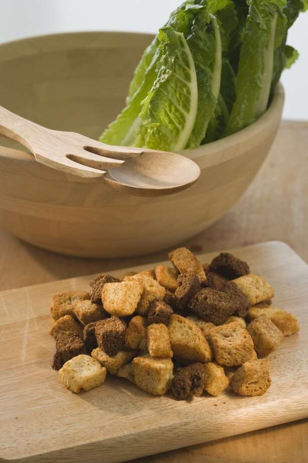 Try to find ways to use expired food, such as stale bread, which could become croutons. Photo: Tom Grill, Getty Images
