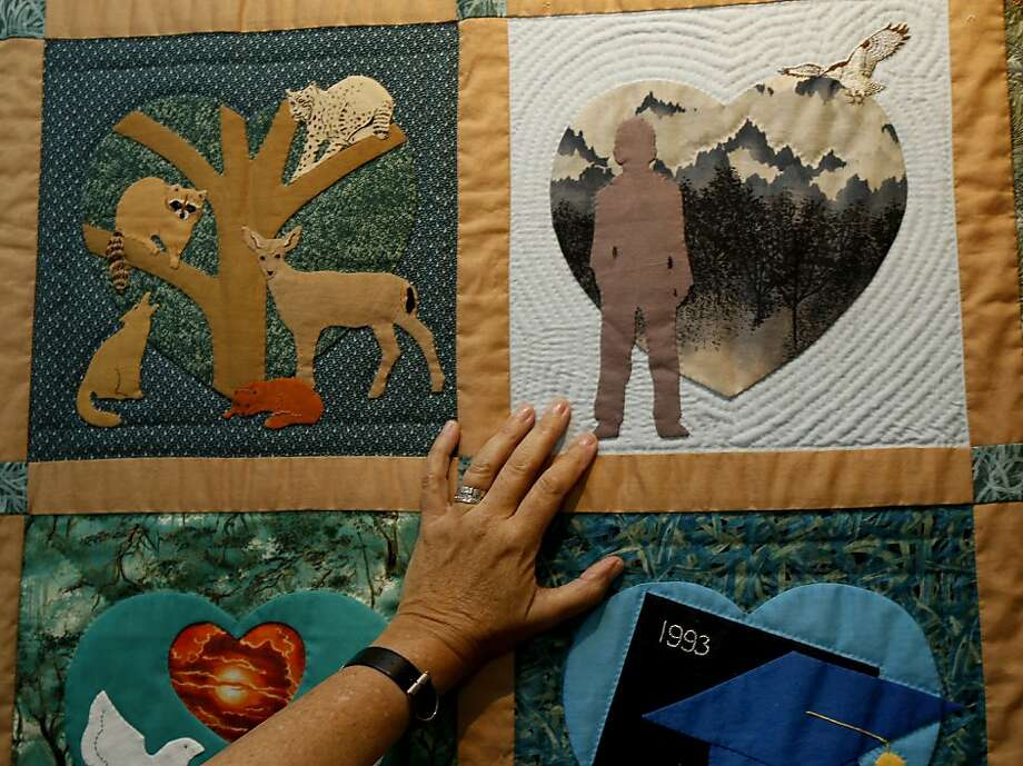 Radha Stern touches a portion of the quilt memorializing her son's short life. Images from the quilt illustrate her new book. Photo: Brant Ward, The Chronicle