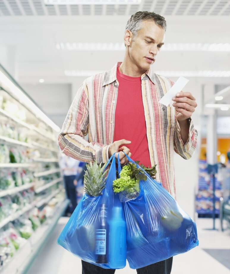 Be sure of what you want before you buy it, and avoid damaging products while in the grocery store. Some stores throw out items they consider to be 'contaminated,' says Earth911.com. Photo: Paul Bradbury, Getty Images/OJO Images RF