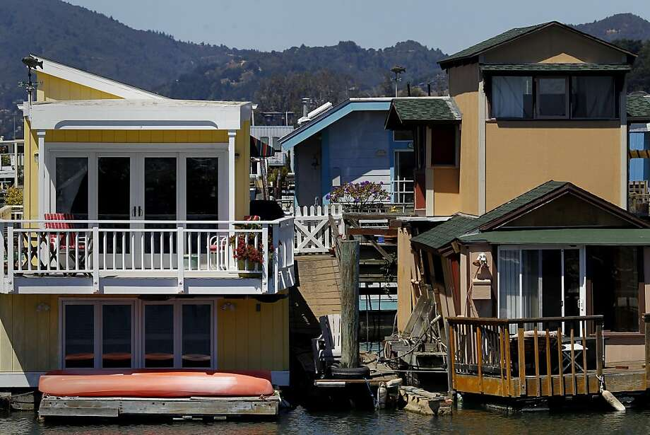Houseboats along the piers are practical and well maintained Tuesday August 27, 2013.  Photo: Brant Ward, The Chronicle