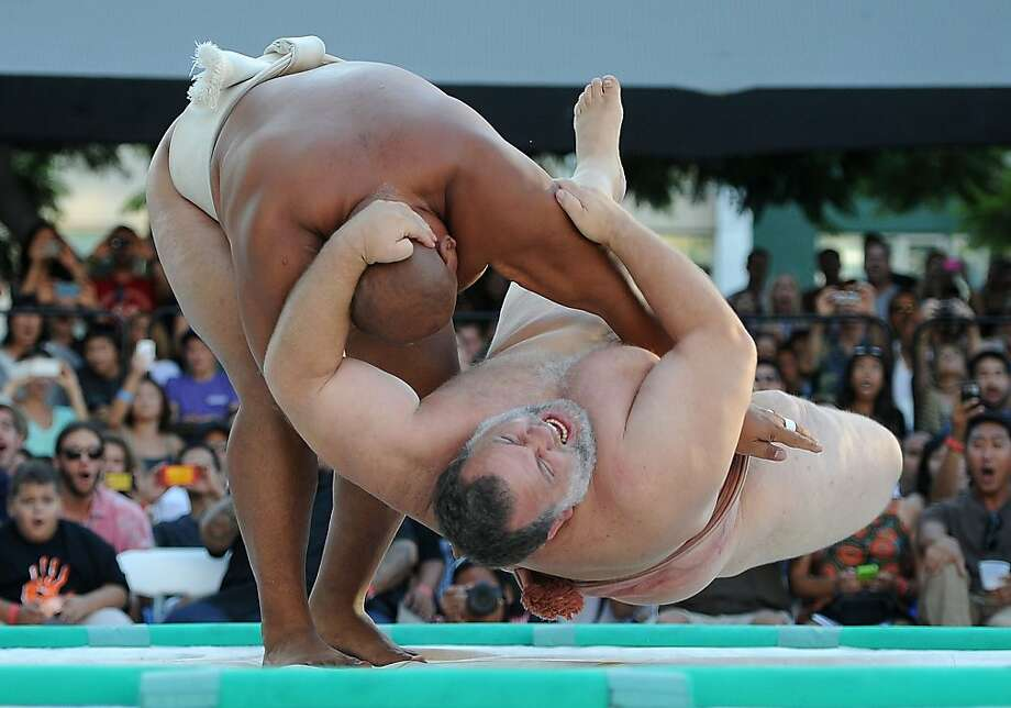 Let's rumble!Seven-time U.S. champion Byambajav Ulambayar of Mongolia slam Kelly Gneiting of the United States to the mat, triggering seismographs in Los Angeles. Ulambayar went on to again win the   heavyweight titleat the U.S. Sumo Open. Photo: Robyn Beck, AFP/Getty Images