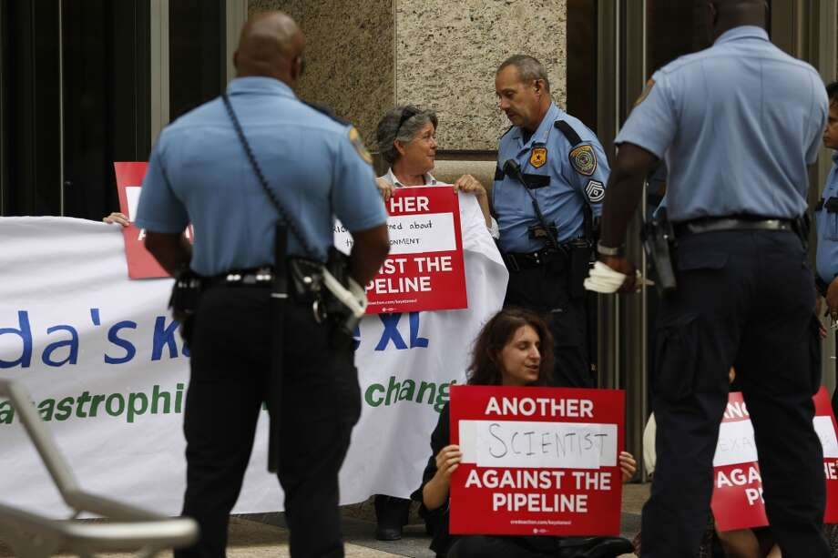Protestors perform civil disobedience by chanting and holding signs while criminally trespassing Sept. 16, 2013 in Houston in front of the TransCanada headquarters in downtown.  (Eric Kayne/For the Chronicle) Photo: Eric Kayne, For The Chronicle