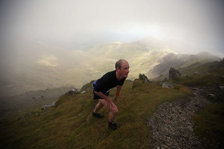 LLANBERIS, WALES - SEPTEMBER 14:  Fell runners approach the summit of Snowden as they compete in the 'Peris Horseshoe Race' which is hosting the Long Course of the Fell Runners Association British Championships on September 14, 2013 in Llanberis, Wales. Runners will cover 17.5 miles over rough terrain and ascend 2590 meters, taking in the summit of Snowdon. The course record for the men was set in 1994 by legendary fell runner Gavin Bland in a time of 3 hours 2 minutes and 49 seconds and the women in 1996 by Menna Angharad in 3 hours 28 minutes and 14 seconds.  (Photo by Oli Scarff/Getty Images) *** BESTPIX *** Photo: Oli Scarff, Getty Images