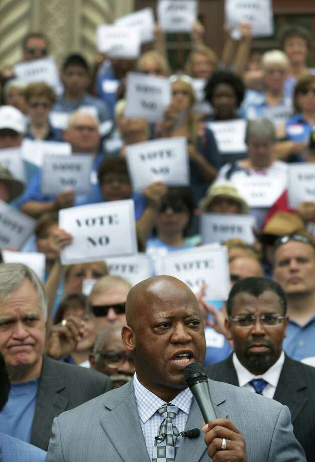 Pastor Charles Flowers of Faith Outreach Center International speaks as members of congregations from area churches gather on the steps of San Antonio City Hall on Tuesday, August 27, 2013, to voice their opposition to the city's nondiscrimination ordinance. Faith Outreach Center is one of three churches that sued the state arguing Texas election law prevented them from supporting recall efforts in San Antonio and Houston.  Photo: San Antonio Express-News / © 2012 San Antonio Express-News