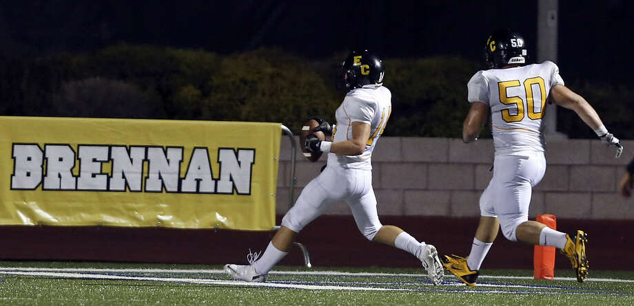 East Central's Russell Brown (left) runs through the end zone with teammate Jeremy Chamberlain after scoring a touchdown against Brennan during second half action Thursday Sept. 12, 2013 at Farris Stadium. Brennan won 49-21. Photo: San Antonio Express-News
