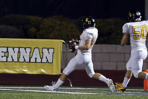 East Central's Russell Brown (left) runs through the end zone with teammate Jeremy Chamberlain after scoring a touchdown against Brennan during second half action Thursday Sept. 12, 2013 at Farris Stadium. Brennan won 49-21.