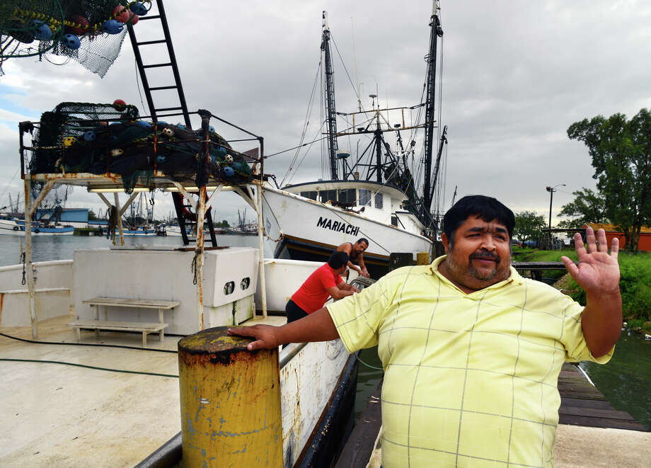 Mauricio Zapata, a shrimp boat captain from Tampicio, Mexico stands on the dock at the Brownsville Shrimp Basin at the port of Brownsville, Texas, Monday, Sept. 16,2013. Zapata and his crew took refuge from Hurricane Ingrid on Saturday night. The shrimpers had been out harvesting shrimp for 2 weeks and were having a good season. Zapata said the crew would return to work on Wednesday once the seas have calmed down. (AP Photo/The Brownsville Herald, Brad Doherty) Photo: Brad Doherty, Associated Press / BROWNSVILLE HERALD