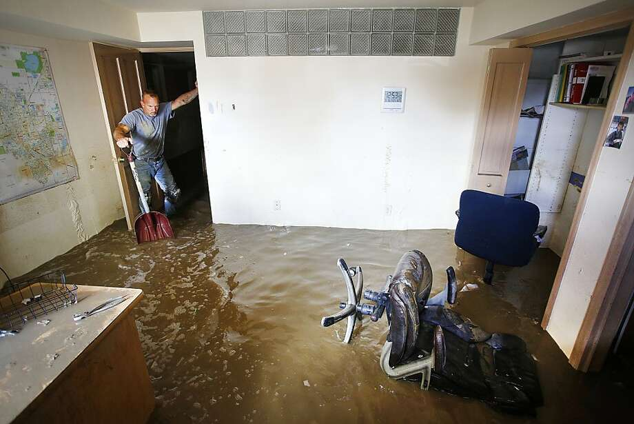 LONGMONT, CO - SEPTEMBER 16: Robert Pandolfi of Longmont, Colorado pauses for a moment while using a shovel to direct water in the basement of his boss' home as residents clean up in the wake of a week of heavy flooding on September 16, 2013 in Longmont, Colorado. More than 600 people are unaccounted for and thousands were forced to evacuate after historic flooding devastated communities in Colorado. (Photo by Marc Piscotty/Getty Images) Photo: Marc Piscotty, Getty Images