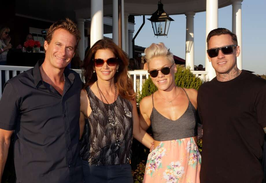 (L-R) Rande Gerber, Cindy Crawford, Pink and Carey Hart attend Eddie Vedder and Zach Galifianakis Rock Malibu Fundraiser for EBMRF and Heal EB on September 15, 2013 in Malibu, California.  (Photo by Jeff Vespa/WireImage) Photo: Jeff Vespa, WireImage