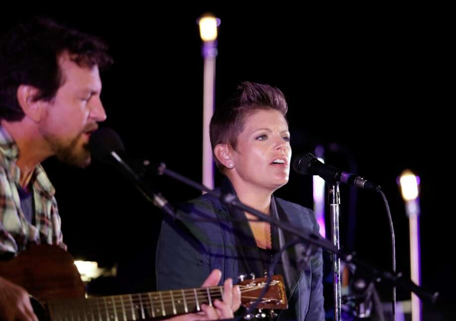 Eddie Vedder and Natalie Maines perform onstage during Eddie Vedder and Zach Galifianakis Rock Malibu Fundraiser for EBMRF and Heal EB on September 15, 2013 in Malibu, California.  (Photo by Jeff Vespa/WireImage) Photo: Jeff Vespa, WireImage