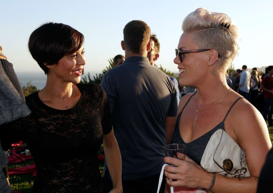 Catherine Bell  and Pink attend Eddie Vedder and Zach Galifianakis Rock Malibu Fundraiser for EBMRF and Heal EB on September 15, 2013 in Malibu, California.  (Photo by Jeff Vespa/WireImage) Photo: Jeff Vespa, WireImage